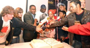 Thompson and several youth volunteers get together to cut the victory cake.