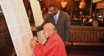 Michael Thompson and executive assistant Ihor D.Wons examine the poll results on election night.