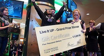 Live It Up contest-winner Nicolette Bryan cheers as she's handed her $5,000 prize Nov. 17 at the Scarborough Town Centre.