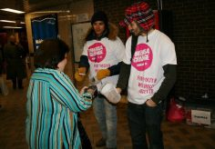Project Humanity events director Daniel Chapman-Smith (right) collects change at Dundas Station on Feb. 11 during the Tokens4Change event.