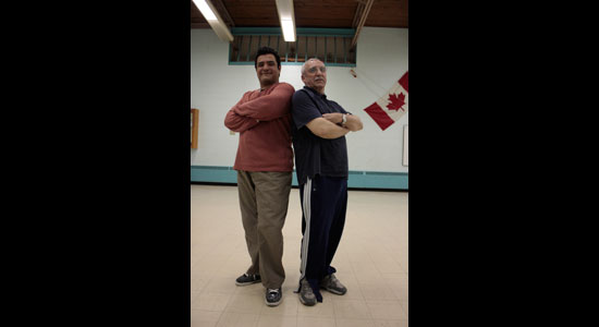 Experienced fencer Tom Partington (right) coaches student Josue Castro (left) in weekly open fencing sessions at Knob Hill United Church.
