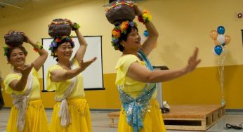 Traditional Chinese dancers show off their skills to a crowd of newcomers to Scarborough.
