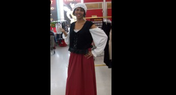A Value Village worker models a pirate wench costume. 'Halloween is our big season,' says store manager Jason Boyle.