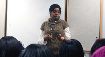 Harris leads the discussion in a session of the Sister 2 Sister program. The group of 12- to 16-year-old girls meets on Thursdays.