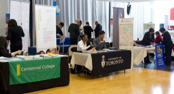 Centennial College and U of T set up information tables at the event.