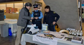 OPP Officers providing information about community service opportunities.