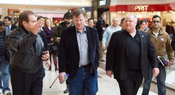 Norm Kelly (left), Gary Crawford (centre) and Mayor Rob Ford take a stroll through the Scarborough Town Centre on Saturday. The two councillors have given their support for a buried Eglinton LRT.