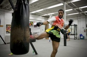 Markus Simon practising his kicks on the heavy bag.