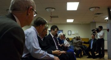 Toronto Scarborough Hospital's CEO John Wright (far left) and his Board of Directors look on as Scarborough senior Lillie Johnson asks a question.