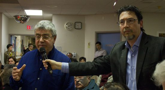 Scarborough resident Andonis Artemorkes, 62, asks CEO John Wright a question about the merger.