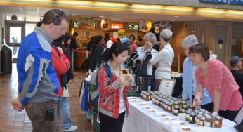 Students look at free jam samples. Flavours such as peach, strawberry and apricot were available.