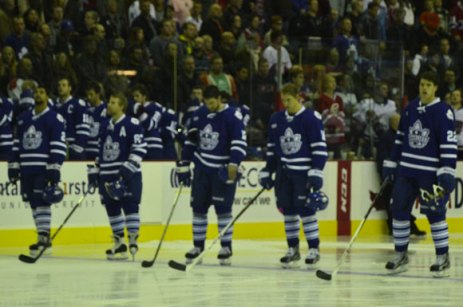 The Toronto Marlies starting lineup stand for the Canadian national anthem before the game.
