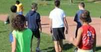 Birchmount Park Collegiate cross-country runners warming up before practice