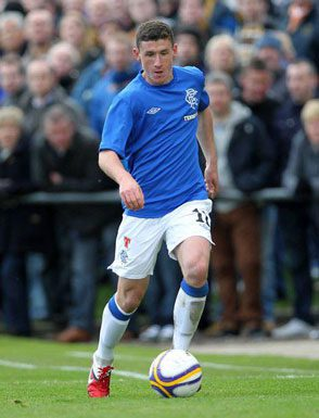 Fraser Aird kicking the ball around while thousands watch on the sidelines.