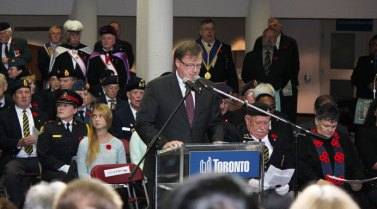 Councillor Gar Crawford acts as MC at Scarborough's Remembrance Day ceremony.