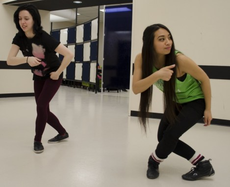 Megan MacDonald (left) and Faye Hue go over their choreography for the competition.