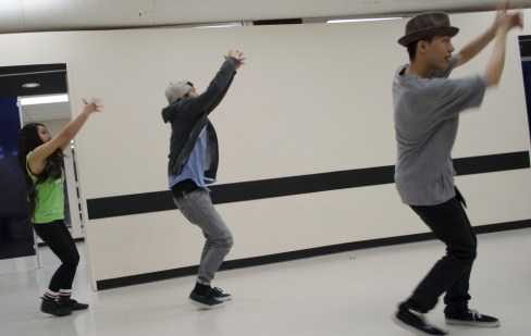 Kevin Ho (right) helps Patrick Pil (centre) and Faye Hue with the choreography.