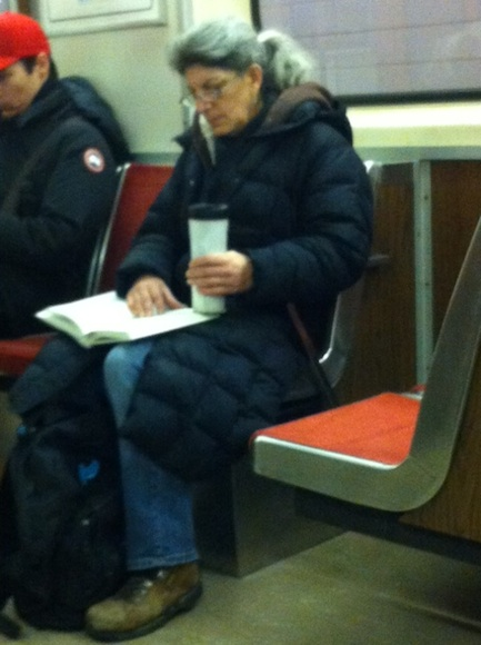 A commuter reads on the TTC, April 2013, during Keep Toronto Reading month.