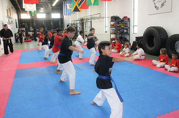 The young students in Team UMAC's kids program practice striking at Team UMAC MMA & Fitness in Scarborough.