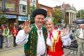 There were many people dressed in traditional Polish clothing, celebrating their culture.