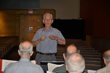 Stan Williams prepares to conduct a song with the group.