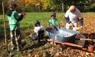 Volunteers use a wheel barrel to transport soil at Highland Creek during the Oct. 20 Great Canadian Shoreline Cleanup event.
