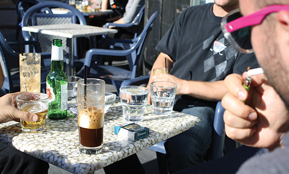Local politicians may favour an outdoor smoking ban... but not some Danforth patio patrons. (Photo by Naomi Grosman)