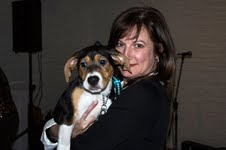 Barbara Steinhoff, the executive director of the Toronto Humane Society with Tanner, a hound puppy from THS that actually got adopted during the event.