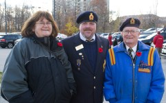 Denise Fleming, Dennis Fleming and Alfred Beese pose before the parade begins.