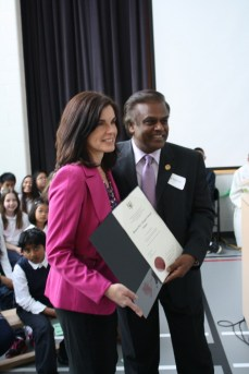 Bas Balkissoon (right) and Principal Cherrier pose with an award.