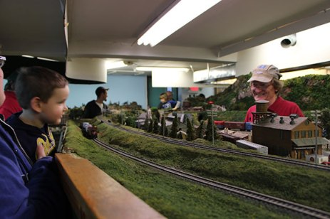 Stephen Ford, right, has been a member at the Scarborough Model Railroaders Club for 30 years. He said this is more of a hobby for him than work. 'You say working, but this is playing,' Ford said. 'This is a hobby. We come down here and run the trains for fun and then we come down here other times to do the necessary maintenance.'