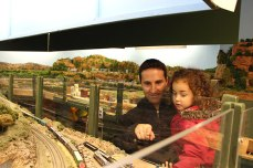 Marcelo Acosta and his children paid a visit to the Scarborough Model Railroaders Club during the Dec. 1 open house. '(My son) loves all the models and watching the tiny things moving around,' Acosta said. 'This one is quite accurately done, the tiny details are beautiful, which is probably the best thing for him.'