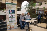 Kevork Tikjian, left, and Koko Masrelian sell New Year's Eve party tickets in the Armenian Community Centre's atrium.
