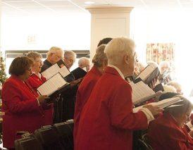 Choir members follow along with lyrics of Christmas carols and other Christmas songs!