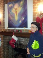 Marita Engel poses beside her oil painting of Jesus Christ that was put on display to be sold at the exhibition.