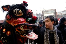 Torontonians brave the inclement weather to watch the lion dance parade.