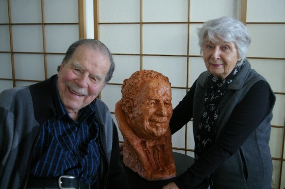 Howard Cable posses alongside his bust and artist Pat Brennen