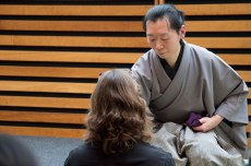 Austin Wong serves a Toronto Tea Festival attendee tea during a demonstration of the Ueda Ryu style of Japanese tea ceremony.