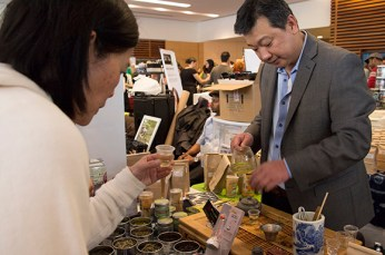 A vendor pours a sample of green tea for a festival attendee at the Toronto Tea Festival on Feb 1.
