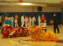 The orange and red dragons lay down for the excited audience.