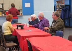 Former association president Brian MacFarlane sits with the seniors.