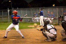 Nate Tennant, left, scored the winning run for the Beers in the sixth inning.