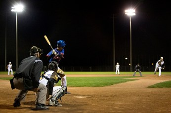 Cam McKnight, left, before driving in Evans to take the lead in the fifth.