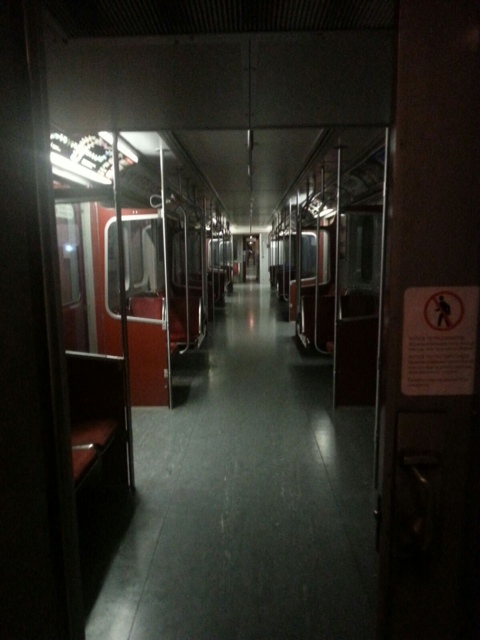 Empty train cars on the darkened TTC at Kennedy Station before Warden