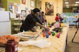 Volunteers working to prepare healthy snacks for students
