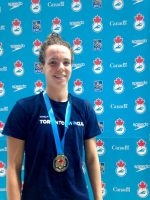 Paige Miler shows off the hardware for winning the 50 metre backstroke on Thursday.