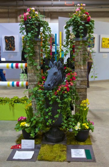 "The exhibit piece, ""Horsepower"", that Joanna Blanchard and her team at Leaside Garden Society created at Canada Blooms. The piece was awarded first place in the Open Design category."