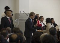 Citizenship and Immigration Minister Chris Alexander shaking hands with new Canadian citizens.