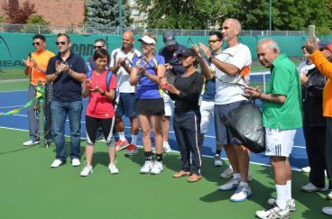 Audience applauding Baranchina's speech at the grand re-opening of the Thorncliffe Park Tennis Club.