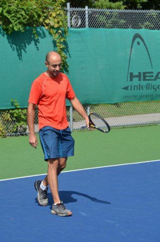 Man enjoying himself at the Thorncliffe Park Tennis Club during the grand re-opening.